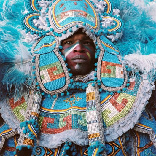 Spy-Boy. A menber of the tribe. The Big Chief is parading at the front of his tribe, usually followed by his «Spy Boys», along with family members. They parade in non-touristic zones, outside of the main crowded itineraries.